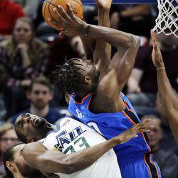 Utah Jazz center Ekpe Udoh fouls Oklahoma City Thunder forward Jerami Grant during NBA basketball in Salt Lake City on Saturday, Dec. 23, 2017.