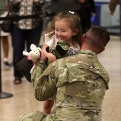 First Lt. Taylor Duke picks up his daughter Leslee Duke at the Salt Lake International Airport in Salt Lake City on Tuesday, Aug. 27, 2019, as he and other members of the Utah National Guard's 4th Infantry Division Main Command Post Operational Detachment return home after serving in Afghanistan for 10 months in support of Operation Freedom's Sentinel.