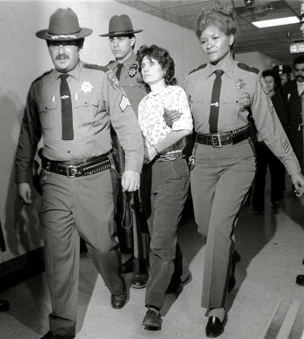 Weather Underground member Katherine Boudin is taken from the Rockland County Courthouse in New City, New York, on Nov. 21, 1981, after her arrest for murder.
