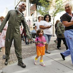 Brad Kroepfl and his daughter Callie participate in the Zombie Walk in Salt Lake City Sunday, Aug. 30, 2015. The eighth annual Zombie Walk was held to raise awareness and donations for the Utah Food Bank.