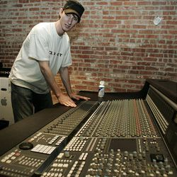 In this photo taken Thursday, Aug. 6, 2009, Chris Schaefer looks over a sound board at the Academy of Contemporary Music  in Oklahoma City.