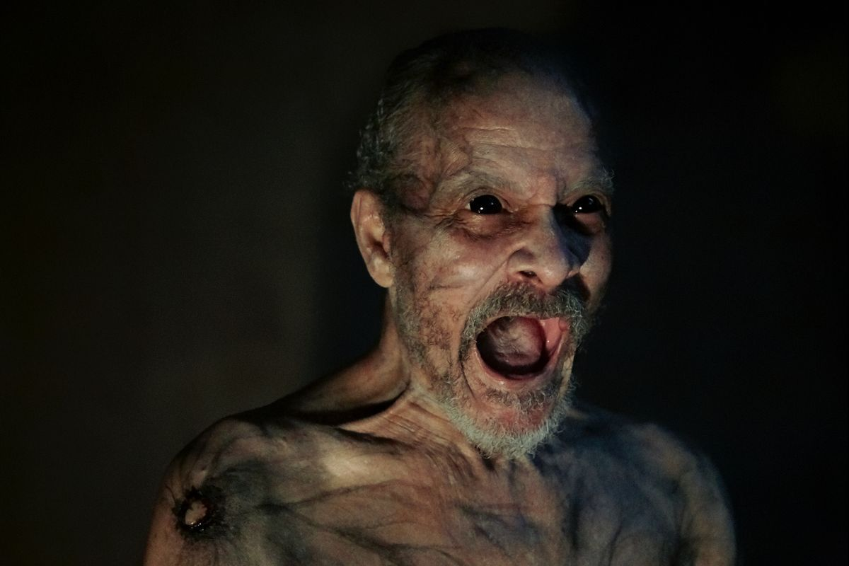 Angry black-eyed grandpa screaming in It Comes At Night