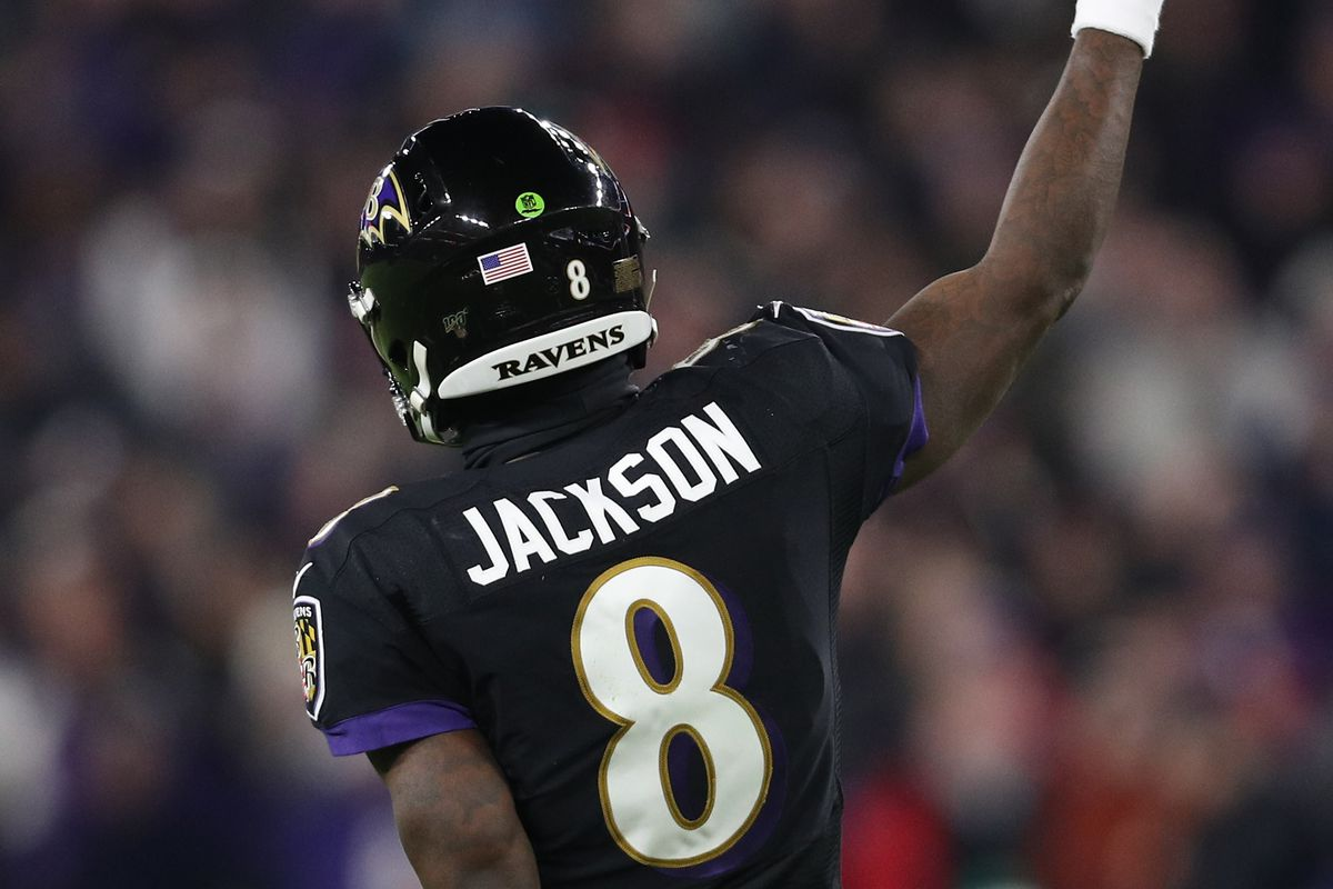 Quarterback Lamar Jackson of the Baltimore Ravens celebrates after a touchdown in the first quarter of the game against the New York Jets at M&T Bank Stadium on December 12, 2019 in Baltimore, Maryland.