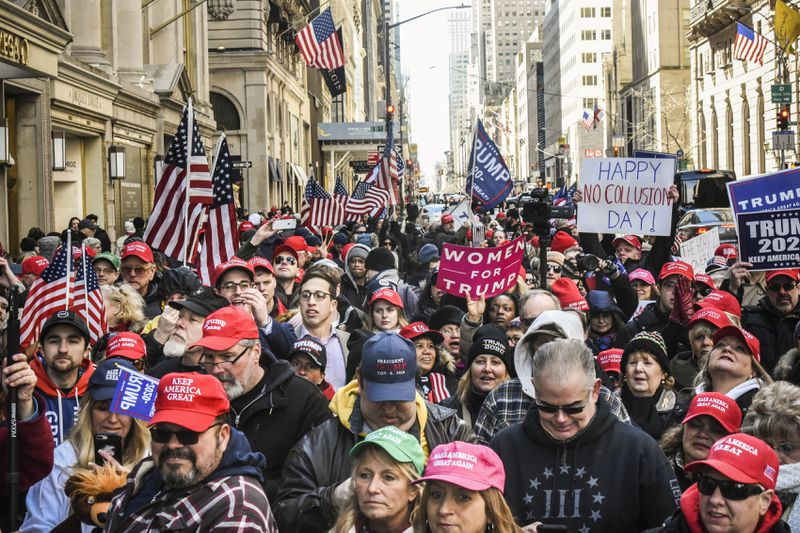People attend a rally in support of President Trump near Trump Tower on March 23, 2019 in New York City.