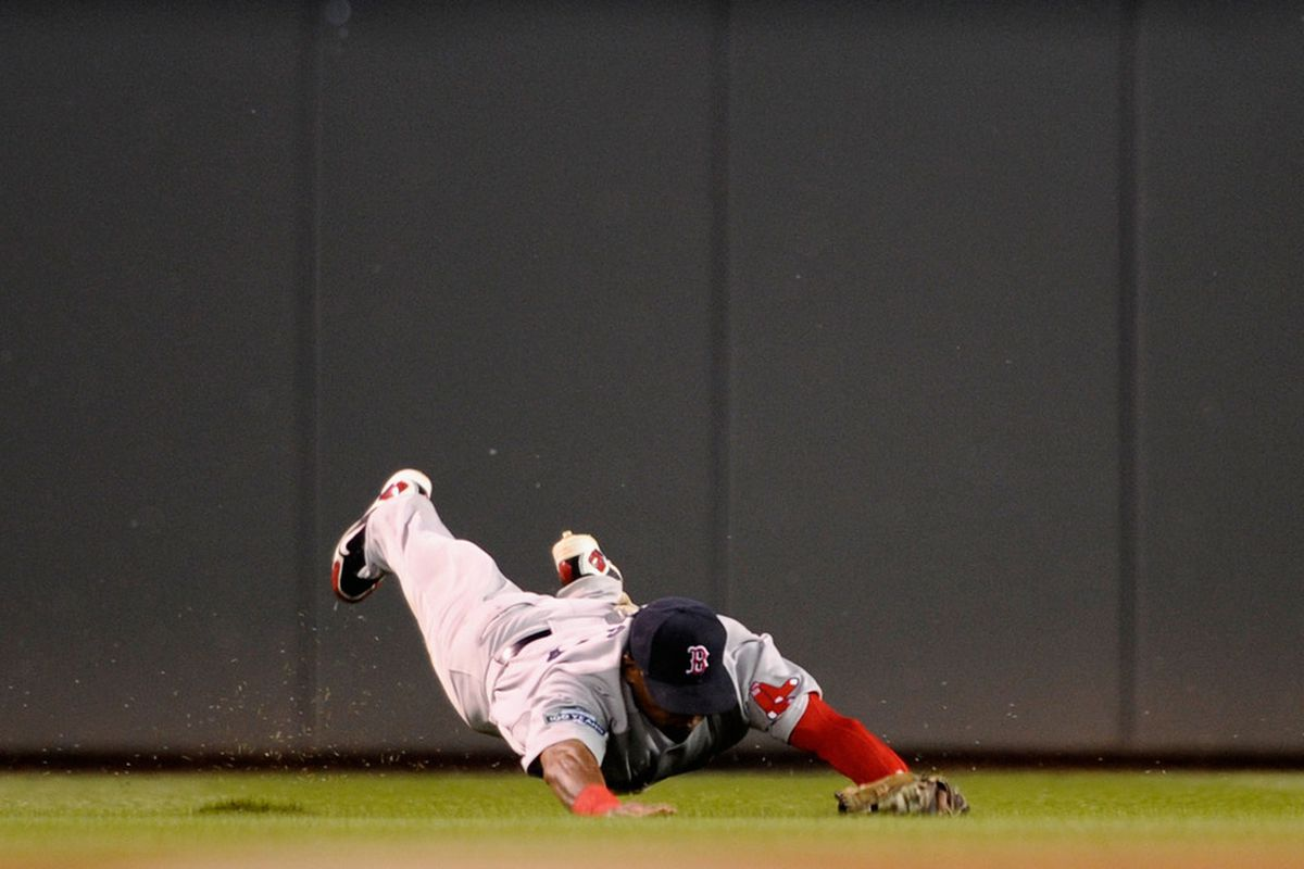 MINNEAPOLIS, MN - Marlon Byrd #23 of the Boston Red Sox makes a catch in center field against the Minnesota Twins during the third inning at Target Field in Minneapolis, Minnesota. (Photo by Hannah Foslien/Getty Images)