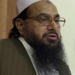 Hafiz Mohammad Saeed, chief of Jamaat-ud-Dawwa and founder of  Lashkar-e-Taiba talks with the Associated Press in Islamabad, Pakistan on Tuesday, April 3, 2012. The United States has offered a $10 million bounty for a Pakistani militant leader who allegedly orchestrated the 2008 Mumbai attacks and has been directing an anti-American political movement in recent months.