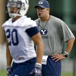 Cougar head football coach Bronco Mendenhall looks on during a workout at the BYU outdoor practice field in Provo Saturday. It was the Cougars' first day of fall camp.