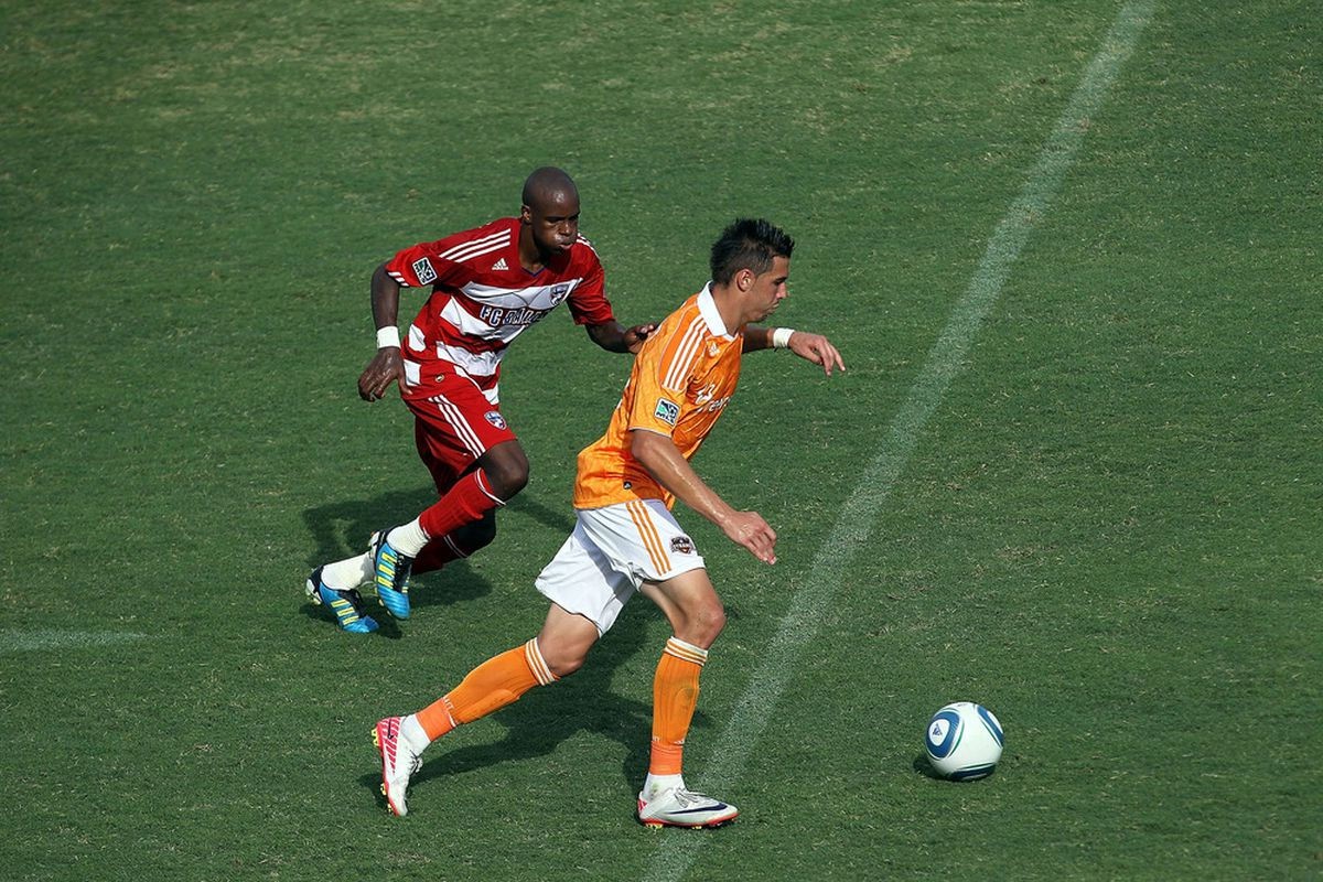 FRISCO, TX - SEPTEMBER 24:  Geoff Cameron #20 of the Houston Dynamo dribbles the ball against Jackson Goncalves #6 of FC Dallas at Pizza Hut Park on September 24, 2011 in Frisco, Texas.  (Photo by Ronald Martinez/Getty Images)