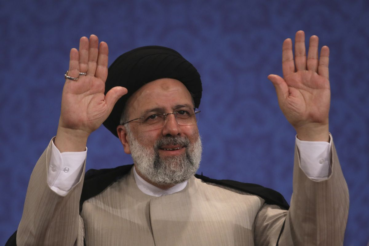 Iran's new President-elect Ebrahim Raisi waves to participants at the conclusion of his press conference in Tehran, Iran, Monday, June 21, 2021. Raisi said Monday he wouldn't meet with President Joe Biden nor negotiate over Tehran's ballistic missile program and its support of regional militias, sticking to a hard-line position following his landslide victory in last week's election.