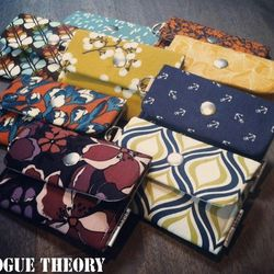 """Fabric tech sleeves by <a href=""""http://www.etsy.com/shop/RogueTheory?page=1"""">Rogue Theory</a>."""