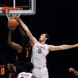 PULLMAN, WA - DECEMBER 2: Washington State center Volodymyr Markovetskyy (15) blocks a shot by an Oregon State player in the first half of the Pac 12 matchup between the Oregon State Beavers and the Washington State Cougars on December 2, 2020, at Beasley Coliseum in Pullman, WA.