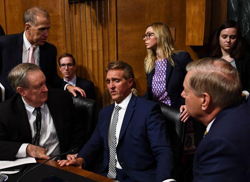 Senate Judiciary Committee member Senator Jeff Flake (R-AZ) speaks with colleagues on the nomination of Brett M. Kavanaugh on September 28, 2018.