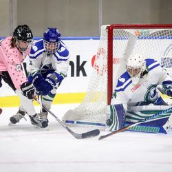 Connecticut Whale goaltender Sydney Rossman gets the blocker down to make a save on forward Kristin Lewicki of the Buffalo Beauts.