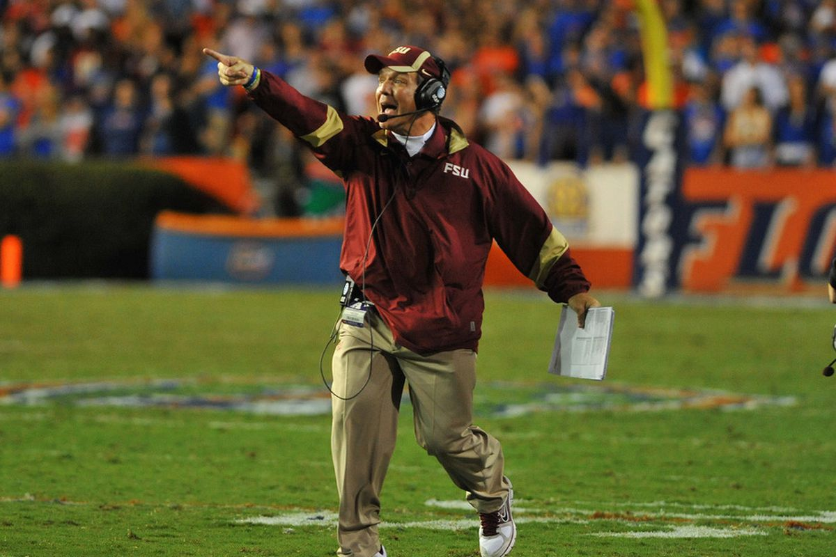 GAINESVILLE, FL - NOVEMBER 26:  Coach Jimbo Fisher of the Florida State Seminoles directs play against the Florida Gators  November 26, 2011 at Ben Hill Griffin Stadium in Gainesville, Florida.  (Photo by Al Messerschmidt/Getty Images)