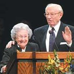 Marjorie Hinckley smiles as President Gordon B. Hinckley praises her at a region conference in Provo last year.