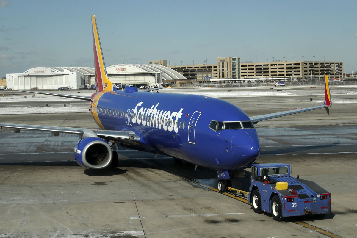 A Southwest Airlines flight is pushed away from a gate at Midway International Airport Friday, Feb. 28, 2020, in Chicago.