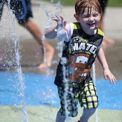 Ander Haus plays in the splash pad at Liberty Park in Salt Lake City on Monday, June 19, 2017.