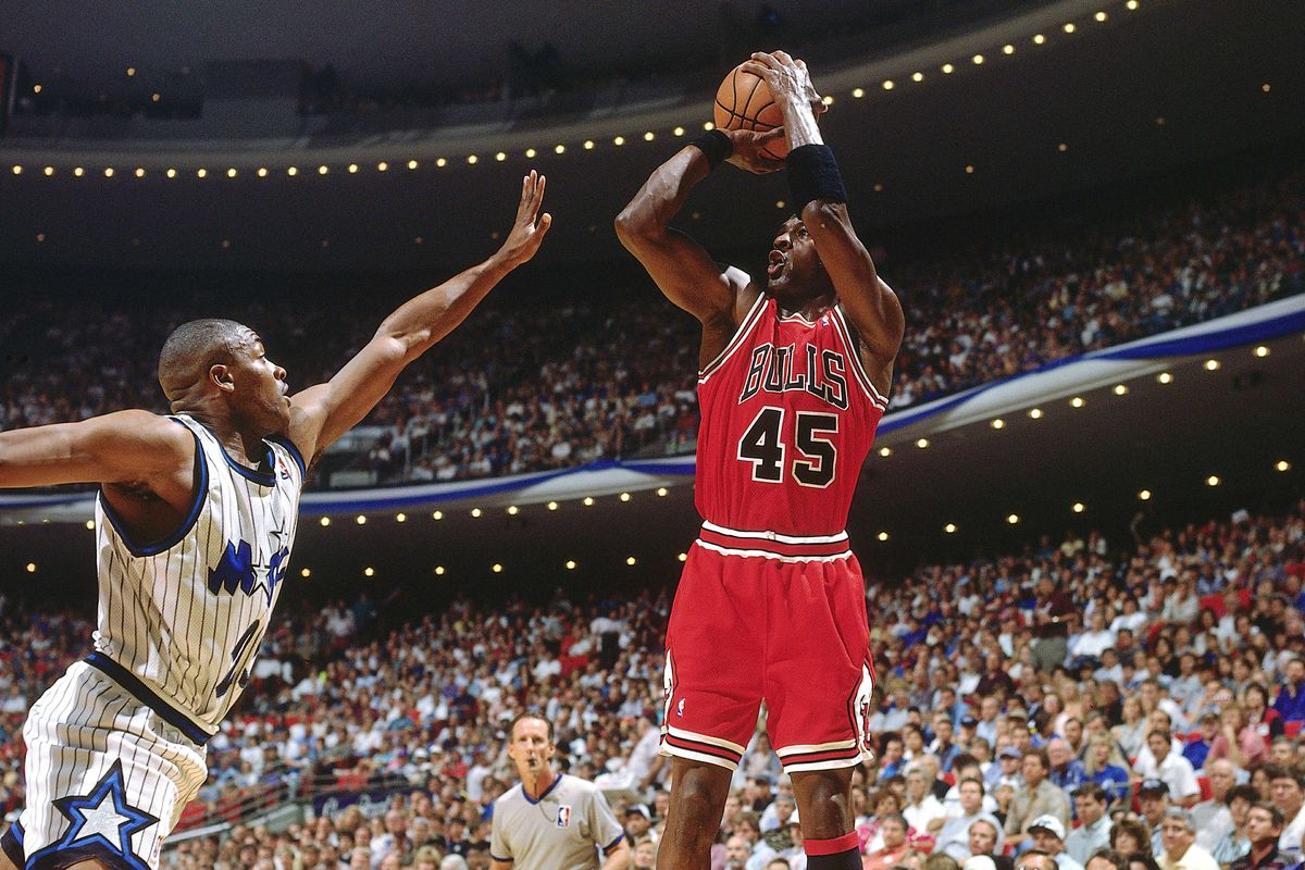 Michael Jordan attempts a jump shot