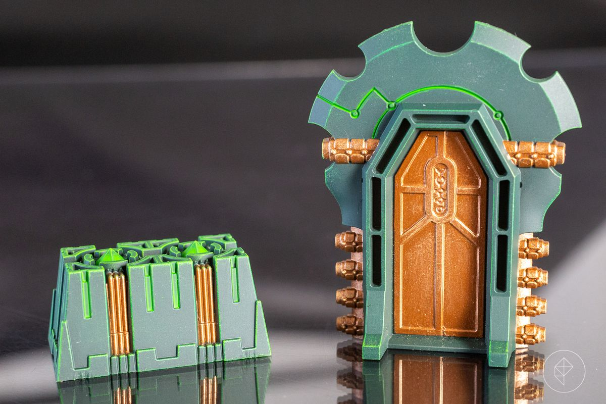Terrain from the Warhammer 40,000: Kill Team Pariah Nexus boxed set is very, very green with gold accents.