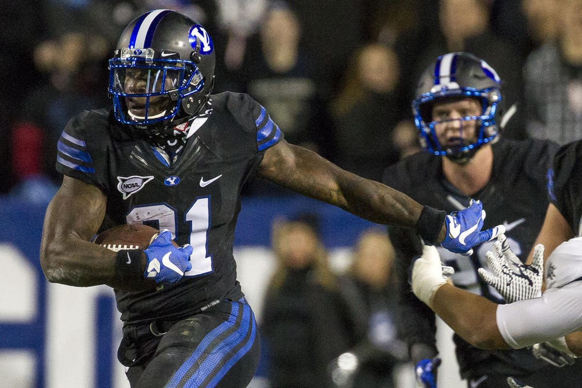 Brigham Young running back Jamaal Williams (21) runs with the ball during an NCAA college football game against Utah State in Provo on Saturday, Nov. 26, 2016.