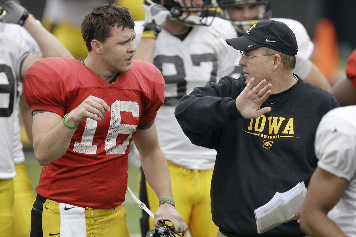 FILE- In this April 14, 2012, filephoto, Iowa quarterback James Vandenberg talks with new offensive coordinator Greg Davis, right, during Iowa's annual NCAA college football spring scrimmage in Iowa City, Iowa. Vandenberg was supposed to be the player the