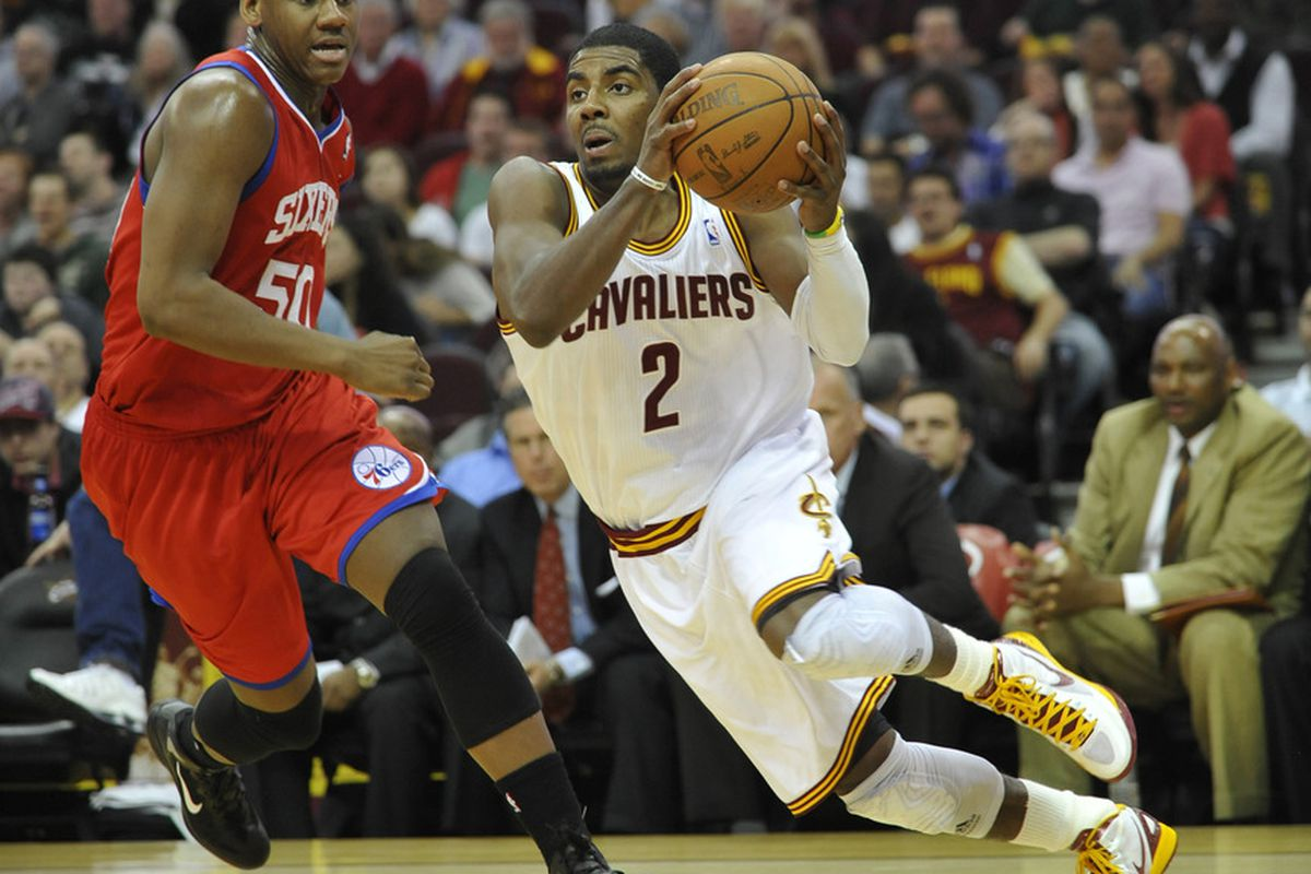 Apr 18, 2012; Cleveland, OH, USA;  Cleveland Cavaliers point guard Kyrie Irving (2) drives past Philadelphia 76ers power forward Lavoy Allen (50) in the third quarter at Quicken Loans Arena. Mandatory Credit: David Richard-US PRESSWIRE