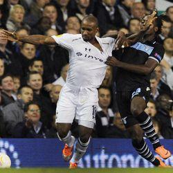 Tottenham Hotspur's Jermain Defoe, left, is challenged by Lazio's Luis Cavanda during a Europa League Group J soccer match at White Hart Lane ground in London, Thursday, Sept. 20, 2012.