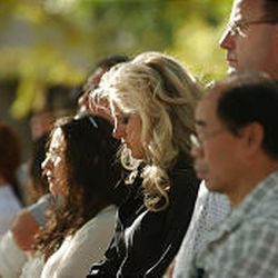 People in attendance reflect during a police memorial service to 9/11 victims at the Calvin Rampton Complex, 4525 S. 2700 West in West Valley City, Friday.