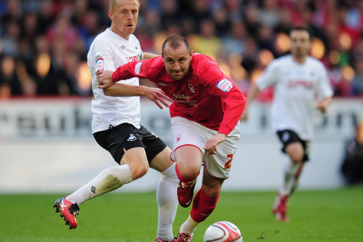 NOTTINGHAM, ENGLAND - MAY 12:  Kris Boyd of Nottingham Forest avoids a challenge from Garry Monk of Swansea City during the npower Championship Play Off Semi Final First Leg in Nottingham, England.  (Photo by Shaun Botterill/Getty Images)