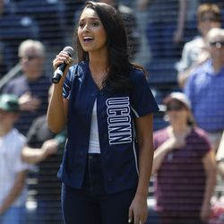 Gina Salvatore sings the national anthem before the Tulane/ UConn baseball game at Dunkin Donuts Park.