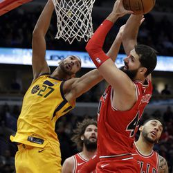 Chicago Bulls forward Nikola Mirotic, right, rebounds the ball against Utah Jazz center Rudy Gobert during the second half of an NBA basketball game Wednesday, Dec. 13, 2017, in Chicago. The Bulls won 103-100. (AP Photo/Nam Y. Huh)