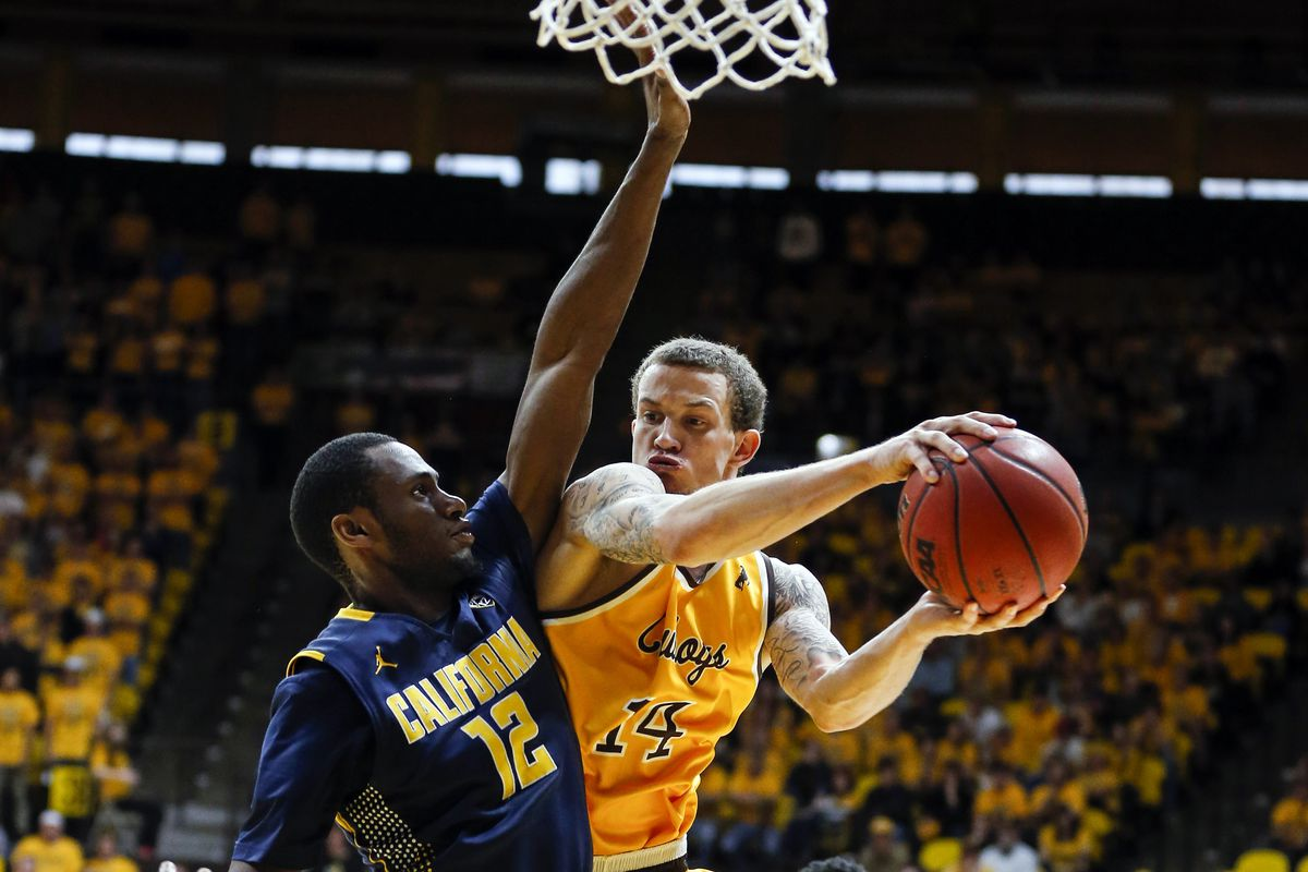 Roger Moute a Bidias' defense on Wyoming's Josh Adams was the key for the Bears in regulations.