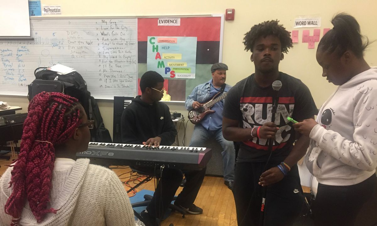 Central High School music teacher Quincy Stewart is a professional musician who got into teaching in his 40s. He played guitar during a choir rehearsal on a recent morning.