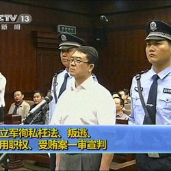 In this Sept. 24, 2012 video image taken from CCTV, Wang Lijun, center, stands while the verdict is announced during his trial at the Intermediate People's Court in Chengdu, in southwestern China's Sichuan province. The Chinese police chief whose thwarted defection exposed murder and infighting in high places was sentenced to 15 years in prison Monday, Sept. 24, 2012, setting the stage for China's leadership to close out the divisive scandal and move ahead with a generational handover of power.