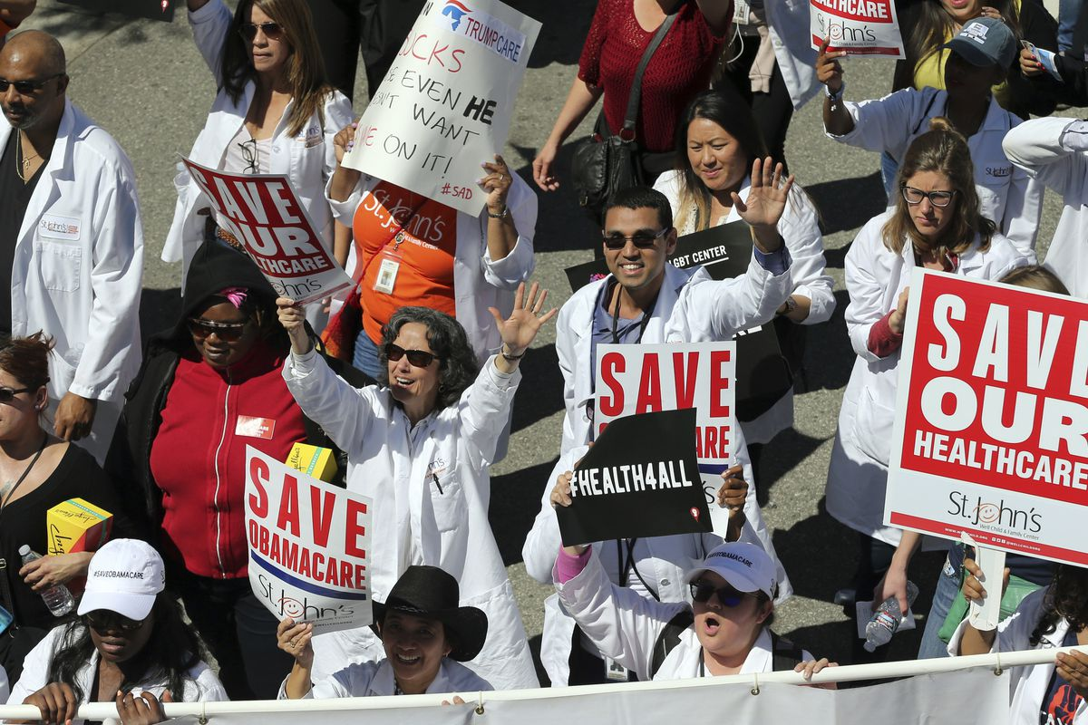 In this March 23, 2017, file photo, health care professionals join hundreds of people marching through downtown Los Angeles protesting President Donald Trump's plan to dismantle the Affordable Care Act.