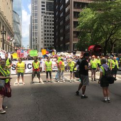 Protesters march in support of immigrant rights through downtown Chicago.