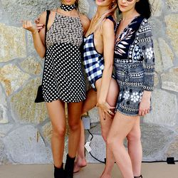Emily Ratajkowski in an ASOS dress, Poppy Delevingne in a Solid & Striped x Poppy Delevingne swimsuit, and Leigh Lezark.
