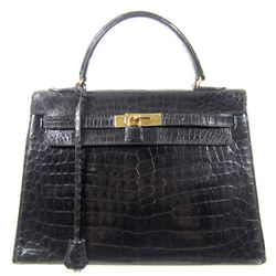 """Vintage Hermès Kelly Bag from the '60s, <a href=""""http://www.shopdecadesinc.com/shop/viewproduct/7644"""" target=""""_blank"""">$19,000</a>. """"This says rich, but discretely. Very Grace."""""""