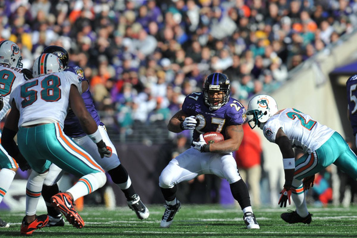 BALTIMORE MD - NOVEMBER 7:  Ray Rice #27 of the Baltimore Ravens runs the ball against the Miami Dolphins at M&T Bank Stadium on November 7 2010 in Baltimore Maryland. The Ravens defeated the Dolphins 26-10. (Photo by Larry French/Getty Images)