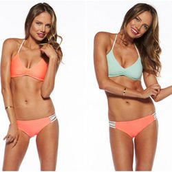 """""""I also love the <b>L*Space's</b> <a href=""""http://www.lspace.com/STRAP-BACK-TOP-Low-Down-Bottom-Full-p6744-c8789.html"""">mix-and-match swim pieces</a>, specifically their reversible strap back halter top ($73) and the low down bottom ($73). I love the fact"""