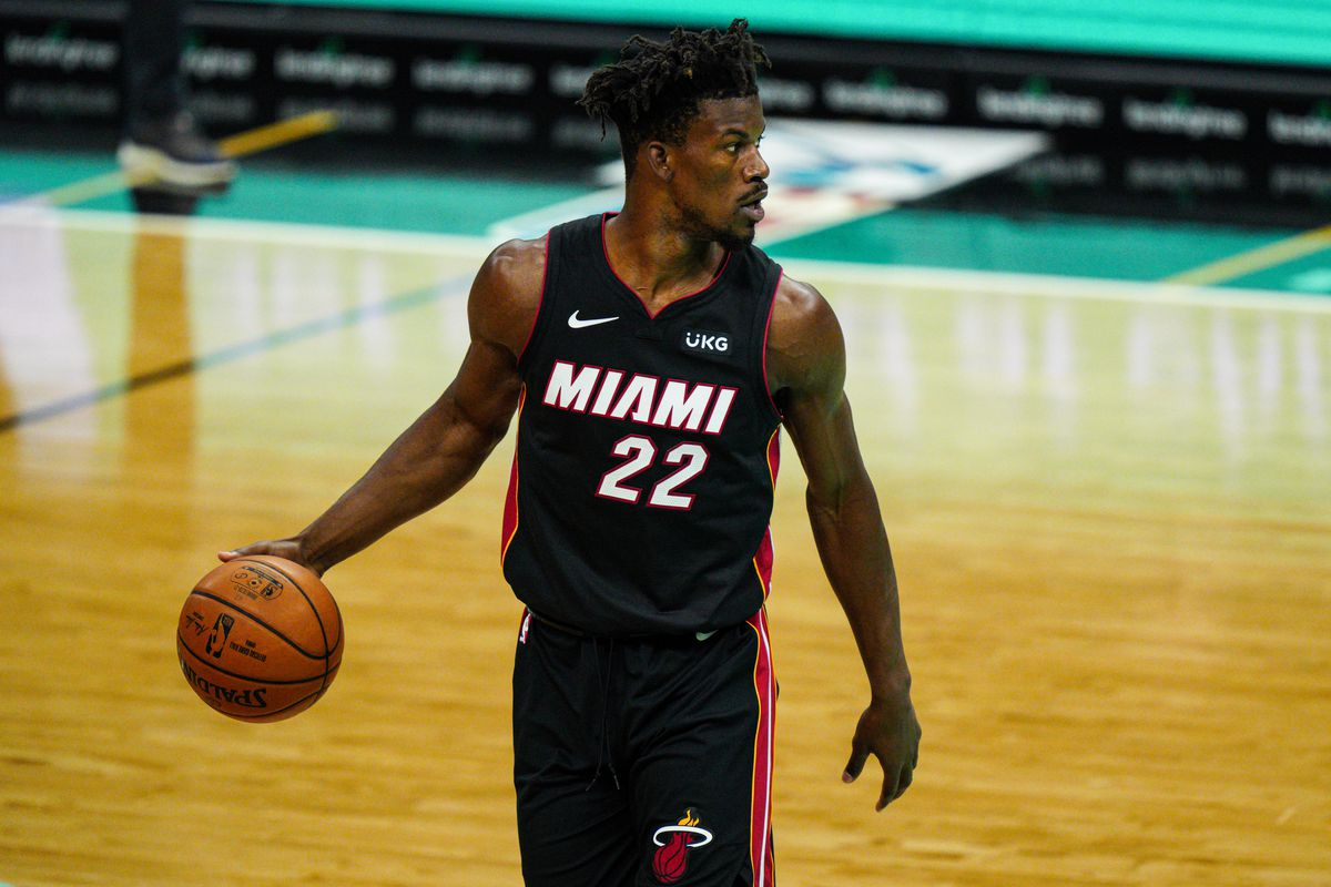 Jimmy Butler of the Miami Heat brings the ball up court against the Charlotte Hornets during their game at Spectrum Center on March 26, 2021 in Charlotte, North Carolina.