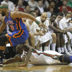 New York Knicks' Baron Davis(85) and Milwaukee Bucks' Larry Sanders reach for a loose ball during the first half of an NBA basketball game on Wednesday, April 11, 2012, in Milwaukee.
