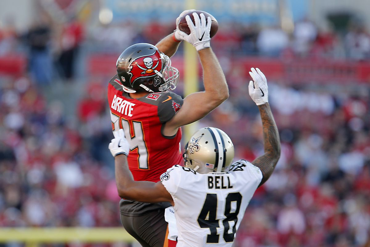 TAMPA, FL:  Tampa Bay Buccaneers tight end Cameron Brate (84) goes up to make a catch over New Orleans Saints safety Vonn Bell (48) during a game at Raymond James Stadium.