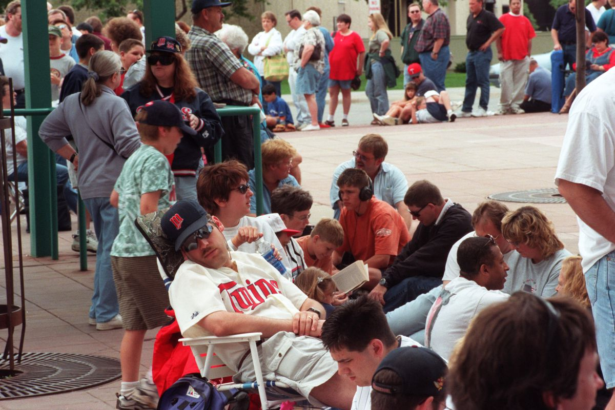 Saturday, June 17, 2000. Kent Hrbeck Bobblehead dolls are handed out. — At the Metrodome√≠s entrance at the corner of Fifth Street and Chicago Avenue, an extensive line of people waited to enter at 3 p.m., three hours before the start of the Twins ga