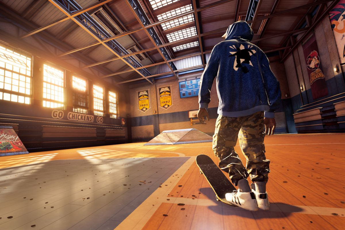 Skater Kareem Campbell stands in a gymnasium from Tony Hawk's Pro Skater 1 and 2