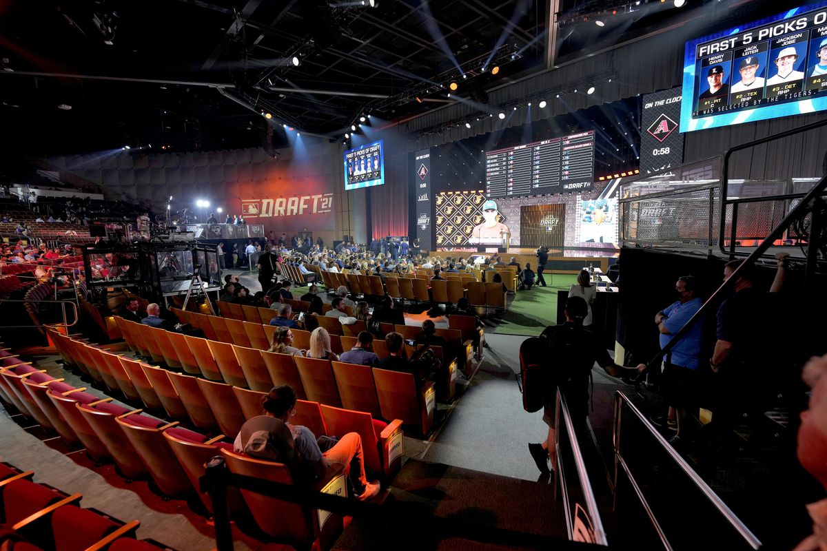 Fans watch during the first round of the 2021 MLB Draft Sunday in Denver.