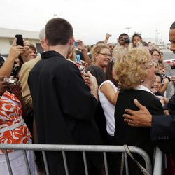 President Barack Obama, right, greets supporters on the tarmac upon his arrival at Toledo Express Airport, Sunday, Sept. 2, 2012, in Toledo, Ohio.