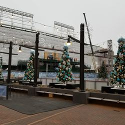 Holiday trees and skating rink with the ballpark in the background