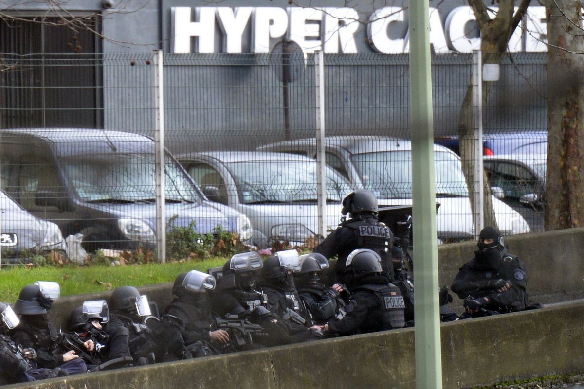 Police outside the kosher supermarket in Paris where a gunman has taken multiple hostages