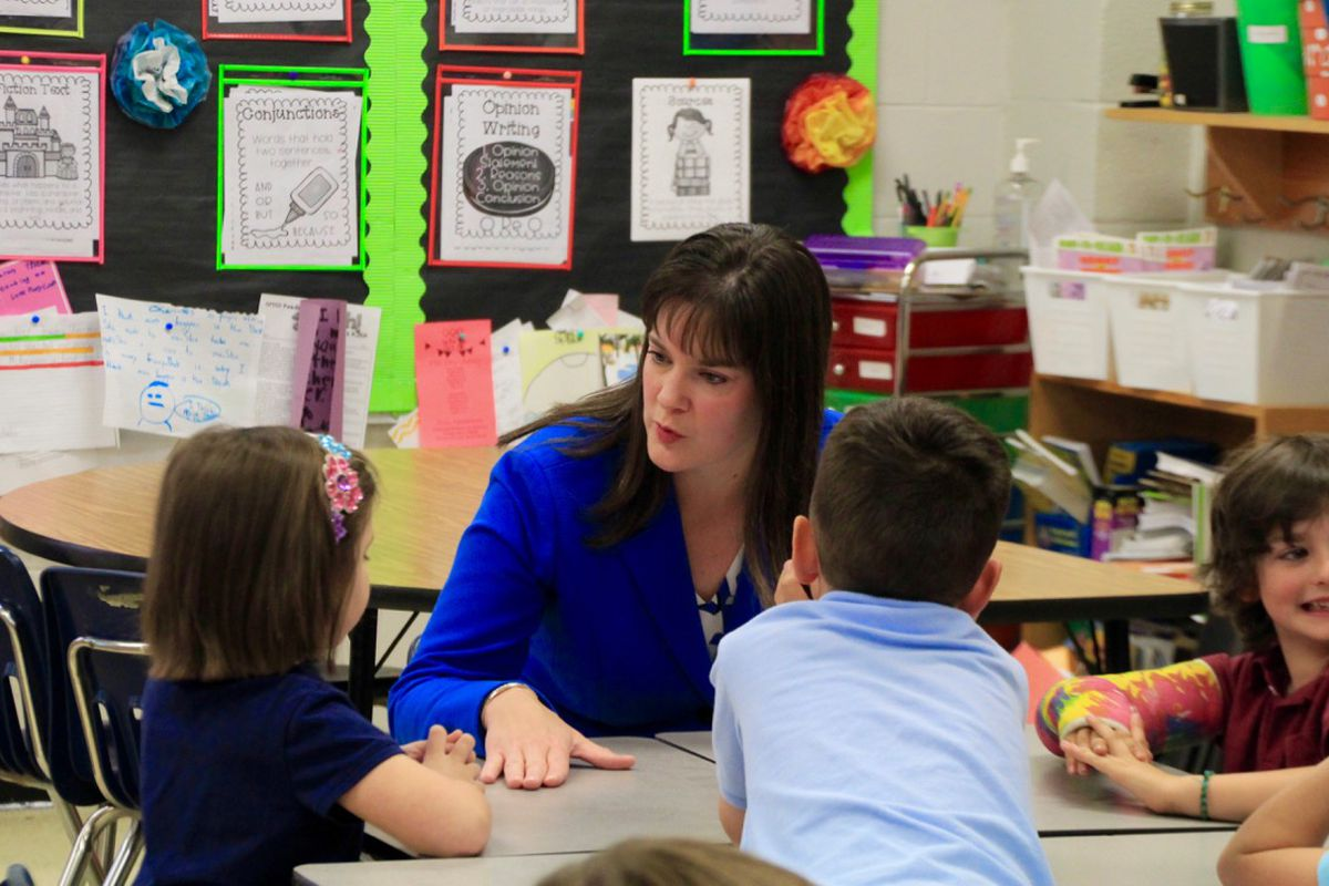 Education Commissioner Candice McQueen visits with students in April at Farmington Elementary School in Germantown.